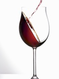 Pouring Red Wine into a Glass Photographic Print by Andreas Wegelin
