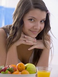 Girl with Fresh Fruit and Orange Juice Photographic Print