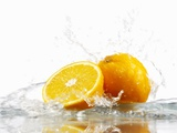 Oranges with Splashing Water Photographic Print by Michael Löffler