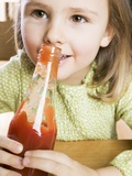 Girl Holding a Bottle of Ketchup Photographic Print