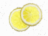 Two Lemon Slices in Water with Air Bubbles Photographic Print by  Kröger & Gross