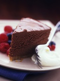 A Piece of Chocolate Cake with Whipped Cream and Berries Photographic Print by Ian Garlick