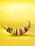 Various Slices of Fruit Shaped into a Banana Photographic Print