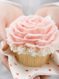 Hands Holding Cupcake with Marzipan Rose Photographic Print