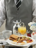 Butler Serving Breakfast Tray with Bacon, Eggs and Toast Photographic Print