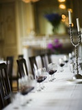 Table Laid in White with Glasses of Red Wine Photographic Print by Per Magnus Persson