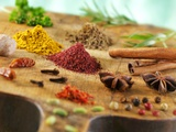 Various Spices on a Wooden Board Photographic Print by Jean-Paul Chassenet