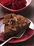 Piece of Chocolate Cake with Chocolate Curls, Red Roses Photographic Print