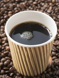 Black Coffee in Paper Cup on Coffee Beans Photographic Print