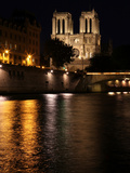 Notre Dame de Paris at night, seen from the quai Saint Michel Photographic Print by Manuel Cohen