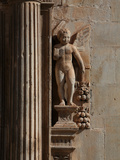 Fluted column flanked by a cherub holding a book, Tortosa, Tarragona, Spain Photographic Print by Manuel Cohen
