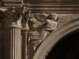 Fluted column and capital with flying angel, portal of the Royal Schools, Tortosa, Tarragona, Spain Photographic Print by Manuel Cohen