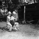 Two Children on a Tricycle Reprodukcja zdjęcia