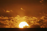 Sun Setting over the Sea with Light Clouds, Fiji, South Pacific, Pacific Photographic Print by Nick Servian