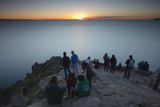 Tourists Watching Sunset from Summit of Cerro Calvario, Copacabana, Lake Titicaca, Bolivia Photographic Print by Ian Trower