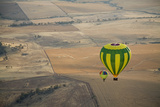 Two Hot Air Balloons Floating over Brown Countryside Near Northam in Western Australia, Australia Photographic Print by Nick Servian