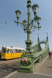 Tram and Cyclist on Independence Bridge Spanning Danube River, Budapest, Hungary, Europe Photographic Print by Richard Nebesky