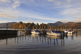Small Boats Docked at Lakeside, Derwentwater, Lake District National Park, Cumbria, England, UK Photographic Print by Ian Egner