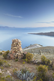 Stack of Prayer Stones on Isla del Sol (Island of the Sun), Lake Titicaca, Bolivia, South America Photographic Print by Ian Trower