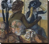 Dans la chapellerie, 1882 Stretched Canvas Print by Edgar Degas