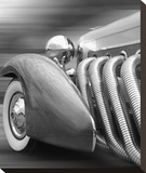 Duesenberg in Motion Stretched Canvas Print by James Richard