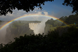 A Rainbow Arches over Victoria Falls Photographic Print by Ralph Lee Hopkins