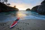 A Wave Washes Up China Cove at Sunset to a Stand Up Paddle Board Photographic Print by Ben Horton