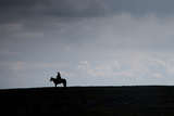 A Man on Horseback on the Mongolian Steppe Photographic Print by Ben Horton