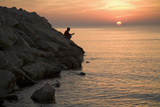 A Man Fishing at Sunrise on the Beach at Larnaka, Cyprus Photographic Print by Scott S. Warren