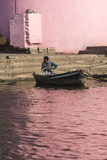 A Man in a Rowboat in Water Tinted Pink by Reflections of a Pink Wall Photographic Print by Jonathan Irish