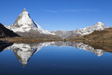 Early Morning Sunlight on the Matterhorn, Reflected in Riffelsee Lake Photographic Print by Jonathan Irish