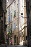A Mother Walks Her Baby in the Back Streets of Montpellier Photographic Print by Taylor S. Kennedy