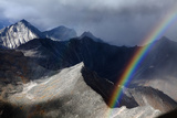 A Rainbow Arcs Above a Mountain Pass in the Brooks Range Photographic Print by Michael Christopher Brown