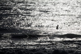 A Surfer Sits Alone Out in the Waves Photographie par Ben Horton
