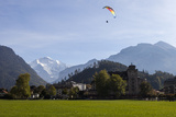 A Paraglider with a View of Jungfrau Mountain from Interlaken Photographic Print by Jonathan Irish