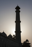 A Silhouetted Minaret at the Taj Mahal at Sunrise Photographic Print by Jonathan Irish