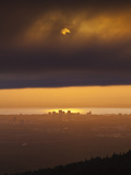 Sunset over Cook Inlet and Downtown Anchorage, Alaska. Photographic Print by Ethan Welty