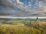 A Man Overlooks the Flathead River, Montana. Photographic Print by Steven Gnam