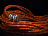 A No..75 Black Diamond C4 Camalot Placed at the Center of a Coiled Rope. Photographic Print by Dan Holz