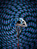 A No.3 Black Diamond C4 Camalot Placed at the Center of a Coiled Rope. Photographic Print by Dan Holz