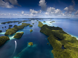 An Aerial View of a Boat as it Speeds Through the Rock Islands, Republic of Palau. Photographic Print by Ian Shive