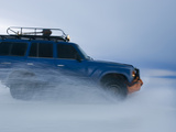 Travelers Drive over a Flooded Salt Flat in Bolivia Photographic Print by Sergio Ballivian