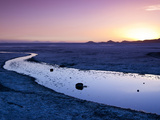 Sunset on the Edge of the Salar De Uyuni on Bolivia's Altiplano. Photographic Print by Sergio Ballivian