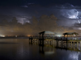 Lightning Off a Dock in Titusville, Florida Looking Towards Cape Canaveral Photographic Print by Melissa Southern