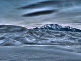 Great Sand Dunes, Co: a Snow Capped Mountain Rises Above the Sand Dunes Photographic Print by Brad Beck