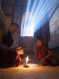 Two Novice Monks Reading Buddhist Texts Inside a Pagoda at Bagan in the Country of Burma (Myanmar) Photographie par Kyle Hammons