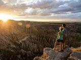A Couple at Sunset in Bryce Canyon National Park in the Summer Overlooking the Canyon Photographic Print by Brandon Flint