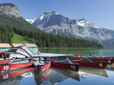 Boat Dock and Canoes for Rent on Emerald Lake, Yoho National Park,British Columbia Photographic Print by Howard Newcomb