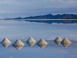 Salt Pyramids Wait for the Sun in a Flooded Salf Flat in Uyuni, Photographic Print by Sergio Ballivian