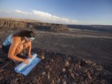 An Evening Outdoor Yoga Session at the Frenchman-Coulee in Central Washington. Photographic Print by Ben Herndon